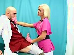 Blond MILF nurse gives a guy a satidying handjob in pink latex gloves