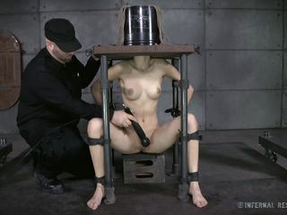 sub gets a bucket on her head and pleasured with a sextoy