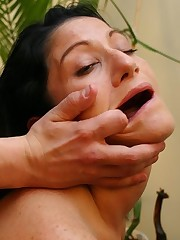 Beautiful, dark-haired lady with large tits sucking cocks