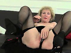 British granny with big tits is a compulsive masturbator