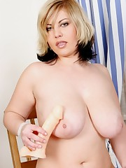 Curvy cutie plays with a big white dong