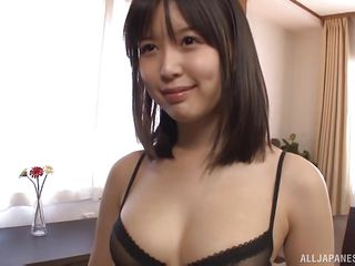cute japanese young sits on her friend's face