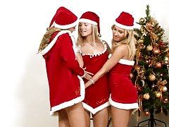 Santa gives these naughty babes a strapon instead of coal