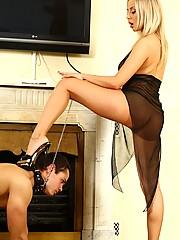 Busty blond beauty's stiletto heels almost pierce through slave's soft skin