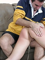 Gorgeous girl grimaces in pain while she's spanked