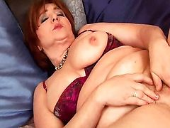 Massive brunette mature with big tits is toying