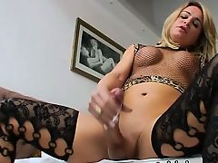 Sexy golden-haired transsexual Camille Andrade shows off body and cums