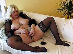 Chubby MILF with large tits dildoing
